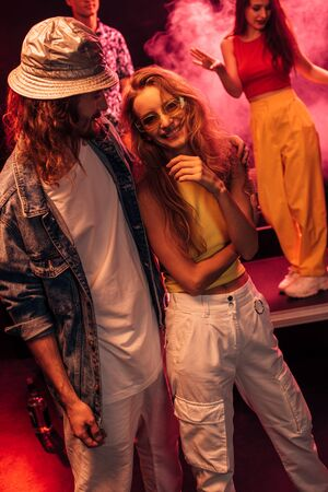 man and beautiful happy young woman during rave party in nightclub Фото со стока