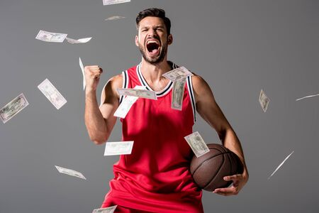 yelling basketball player with ball Isolated On grey with falling money