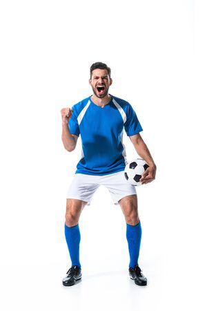 excited soccer player with ball and clenched hand yelling Isolated On White Reklamní fotografie