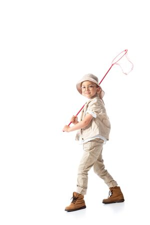 full length view of explorer kid in hat holding butterfly net isolated on white Banco de Imagens - 130117303