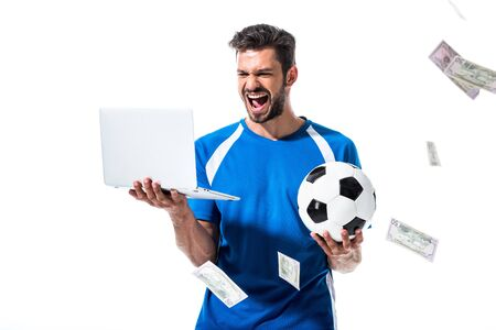 cheering soccer player with ball and laptop near falling money Isolated On White