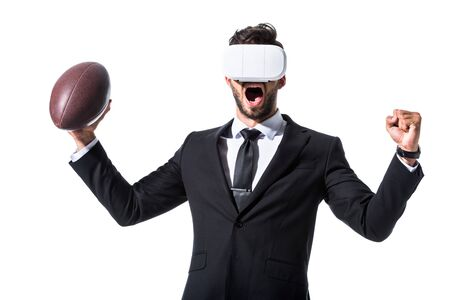 cheering businessman in virtual reality headset with rugby ball and clenched hand Isolated On White Reklamní fotografie