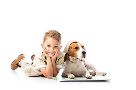 preschooler explorer kid with map and beagle dog on white Banco de Imagens - 130117614