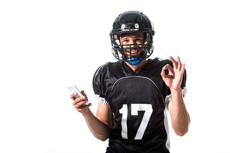 American Football player with smartphone and okay sign Isolated On White Фото со стока