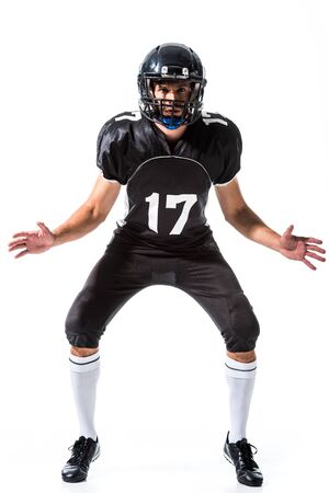 Giocatore di football americano che gesturing isolato su bianco