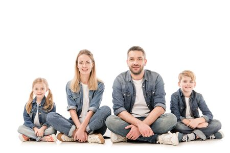 happy family in jeans sitting isolated on white Stock Photo