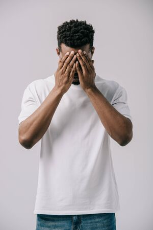 african american man covering face with hands isolated on grey Stock fotó