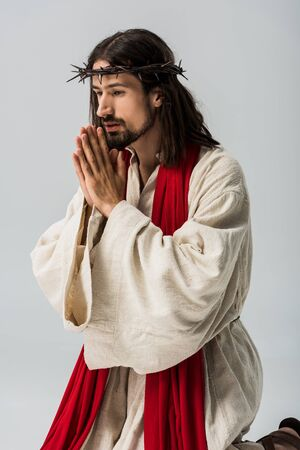 religious man with praying hands and jesus robe isolated on grey Stock Photo