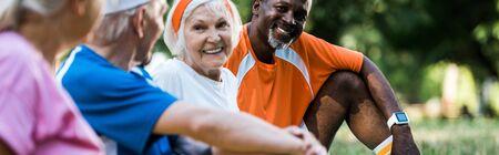 panoramic shot of cheerful multicultural men and women in sportswear Foto de archivo - 130215639