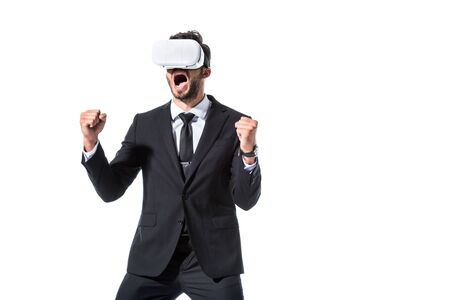 cheering businessman in virtual reality headset with clenched hands Isolated On White Фото со стока