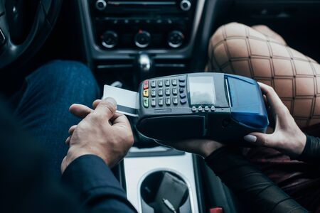 top view of client paying by credit card near prostitute in car Stock fotó