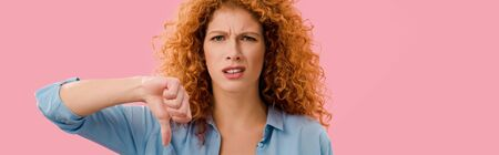 redhead woman showing thumb down Isolated On pink Banco de Imagens - 130326469