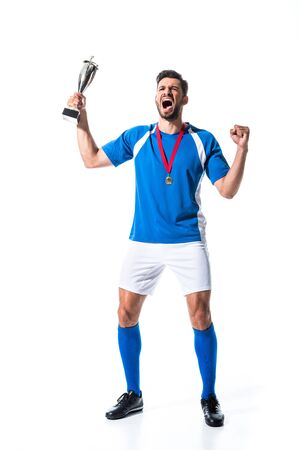 excited soccer player with trophy cup and medal Isolated On White