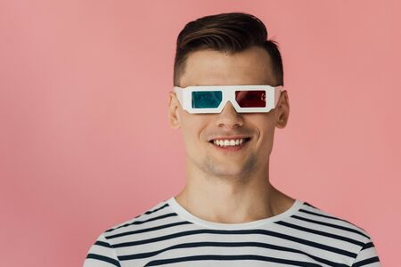 front view of smiling young man in 3d glasses isolated on pink