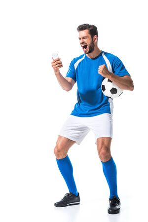 excited soccer player with ball using smartphone Isolated On White Imagens