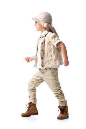side view of explorer child in hat standing on white Stock Photo