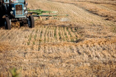 selective focus of modern tractor on wheat field Stock Photo