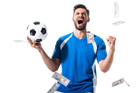 yelling soccer player with ball and laptop near falling money Isolated On White Reklamní fotografie