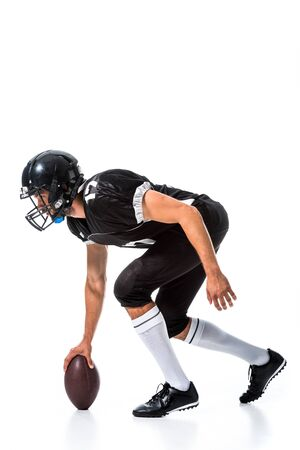 side view of American Football player with ball Isolated On White Фото со стока