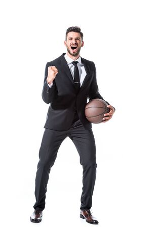 excited businessman in formal wear with basketball and clenched hand Isolated On White Reklamní fotografie