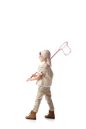full length view of explorer boy in glasses holding butterfly net isolated on white