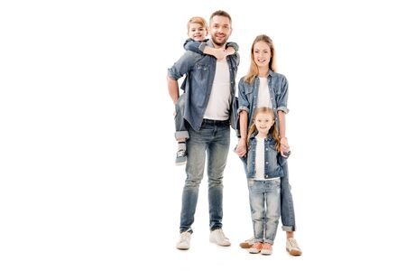 full length view of happy family in jeans smiling isolated on white