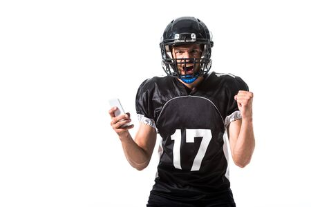 yelling American Football player with smartphone and clenched hand Isolated On White