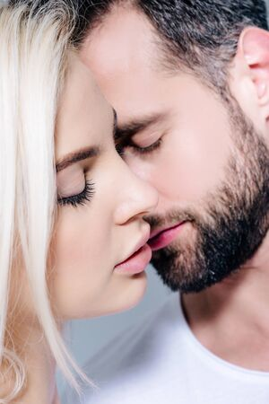 beautiful young romantic couple with closed eyes Stockfoto