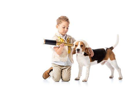preschooler explorer boy with spyglass and beagle dog on white Banco de Imagens - 130116649