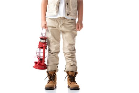 cropped view of explorer boy holding red lantern on white