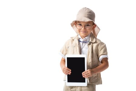 smiling explorer child in glasses and hat holding digital tablet with blank screen isolated on white Banco de Imagens - 130117038