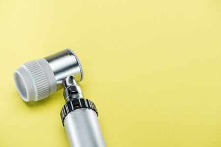 close up view of dermatoscope on yellow background
