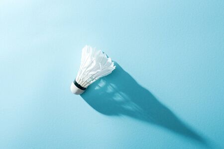 top view of white shuttlecock with feathers on blue Stock Photo