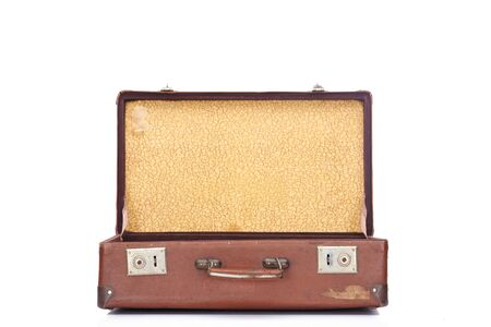leather brown vintage opened suitcase isolated on white