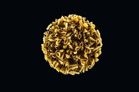 top view of mixed pasta in circle isolated on black