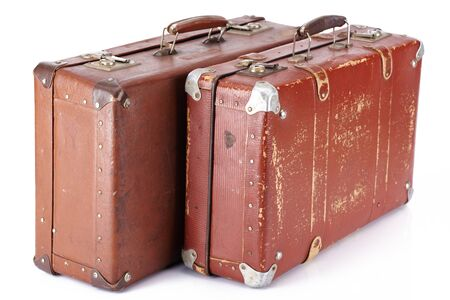 two leather brown retro suitcases isolated on white