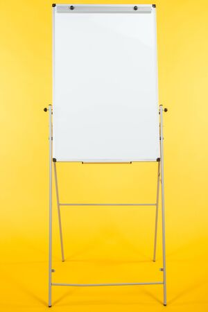 white flipchart with copy space isolated on yellow Stok Fotoğraf