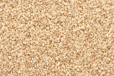 top view of uncooked pressed organic oats Banco de Imagens