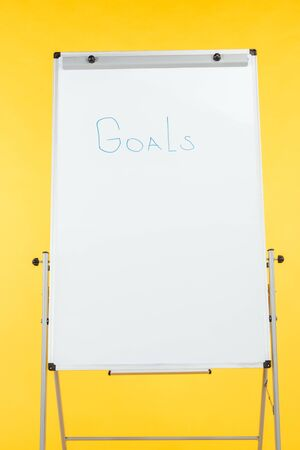 word goals written on white flipchart with copy space