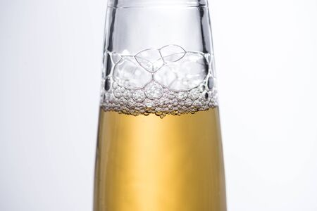 close up view of beer bottle with bubbles isolated on white Stock Photo