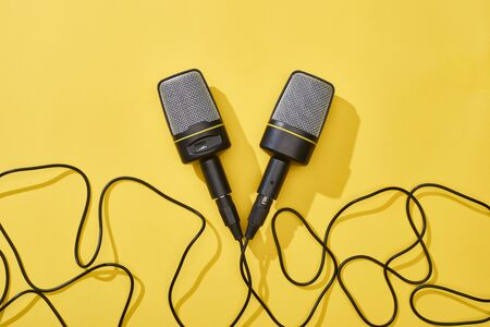 top view of microphones on bright and colorful background with copy space 版權商用圖片