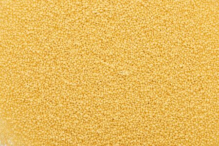 top view of uncooked organic couscous groat Stock Photo