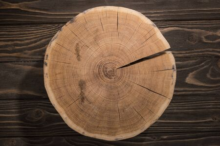 top view of wooden cutting board on brown table