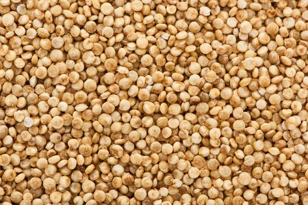 top view of uncooked seeds of organic white quinoa