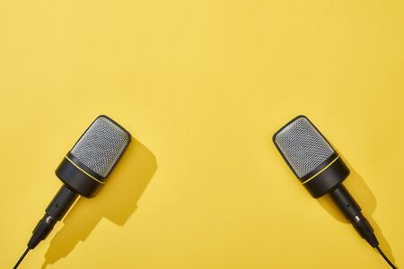 top view of microphones on bright and colorful background
