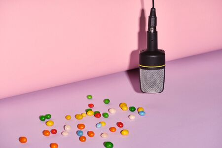 black microphone with candies on bright and colorful background with copy space 版權商用圖片