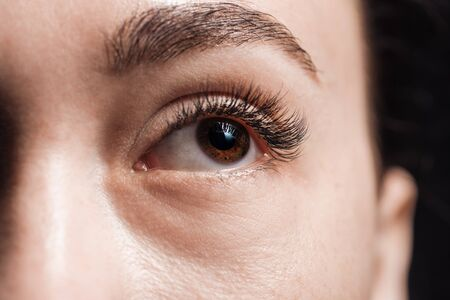 close up view of young woman brown eye looking away