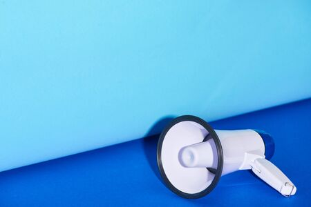 loudspeaker on bright and colorful background with copy space