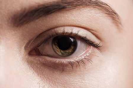 close up view of human brown eye looking at camera Stock fotó
