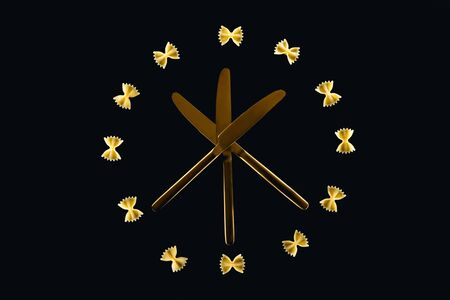 top view of farfalle pasta in circle with three crossed knives in middle isolated on black